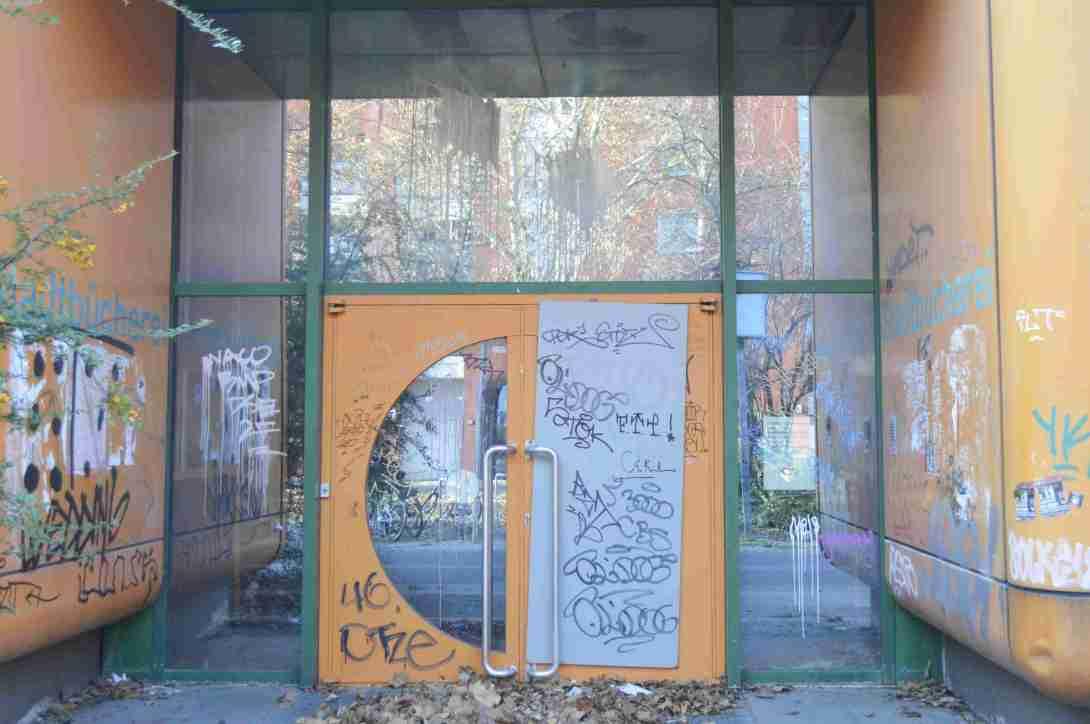 door of abandoned school in Berlin